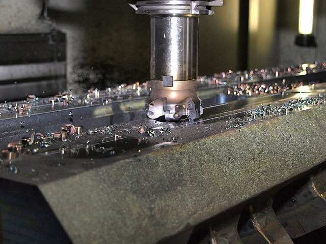 an industrial milling machine at work